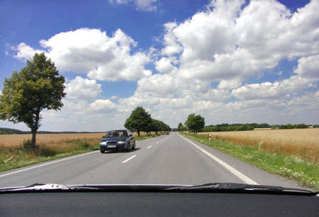 View of a summer czech road from a vehicle interior photo