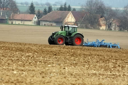 tractor at work on a field photo