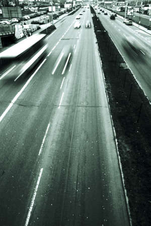 Highway with lots of cars. Green tint, high contrast and motion blur to rise speed. Down with place for text. Stock Photo - 6395721