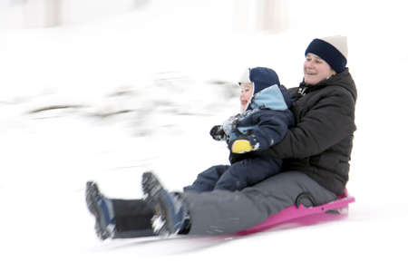 bobsleigh: Mother with son on bobsleigh Stock Photo