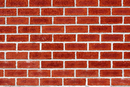 red wall: brick wall - periodic whites line on red brick Stock Photo