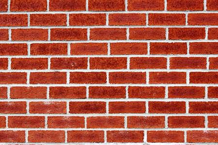 brick wall - periodic whites line on red brick Stock Photo