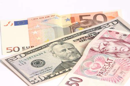 korun: paper moneys - 50 dollar,  50 euro and 50 Korun on white background