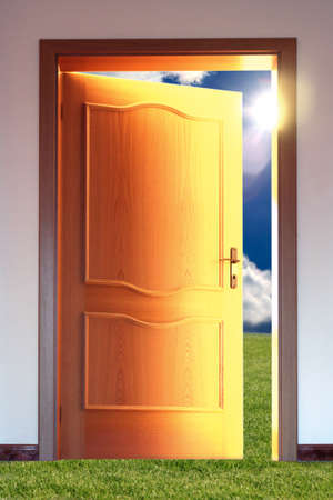 obscurity: Opened door to blue sky with sun and grass - conceptual image