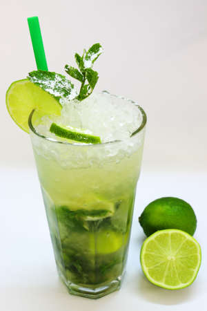 mixed alcoholic drink - isolated mojito with lime and mint
