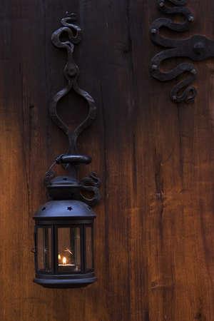 lampe: wood door with romantic iron lampe