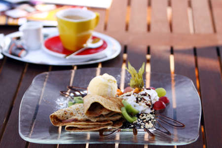 pancake with chocolate, vanilla ice-creme and fruit photo