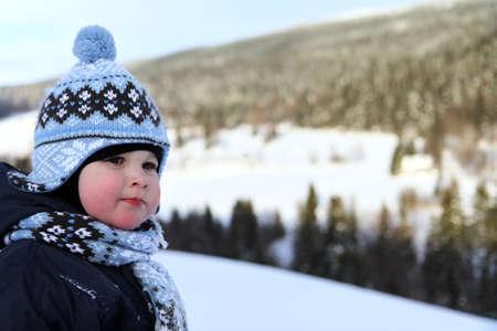 krkonose: portrait small boy in winter on mountains Krkonose Stock Photo
