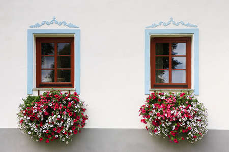 close-up two wood old windows with flowers photo