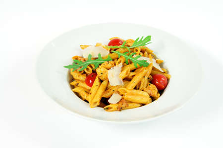 Penne alla vodka with chicken meat and salad rucola