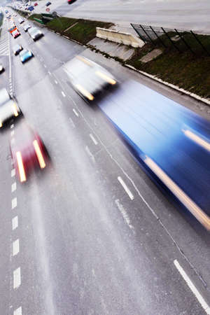 Highway with lots of cars. High contrast and motion blur to rise speed. photo