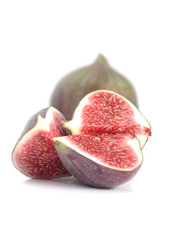 purple fig: Fresh figs isolated on a white background