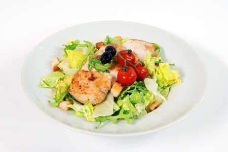 caesar salad: Caesar salad with chicken steak on white background