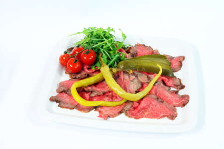 gherkin: Roastbeef with gherkin and hot pepper on white background