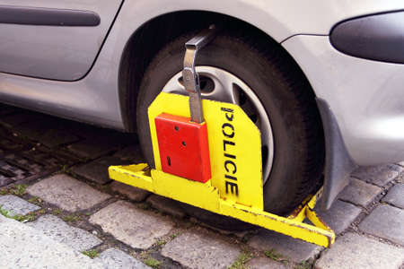 illegally: Clamped wheel - close-up car with boot Stock Photo