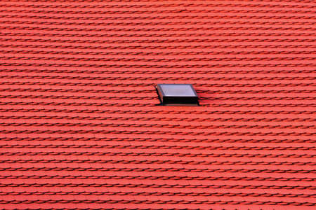abstract background - red roof with one window photo