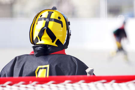 fielding a young hockey goalie in goal Stock Photo
