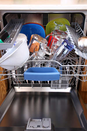 open dishwasher with clean dishes in kitchen