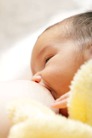 Newborn baby breast feeding breast