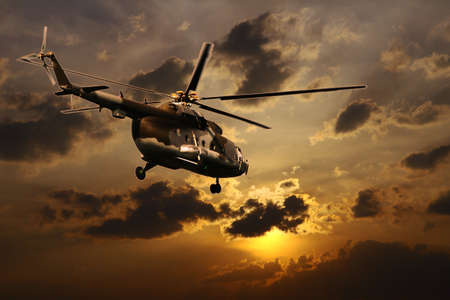 war and military: Helicopter landing at sunset