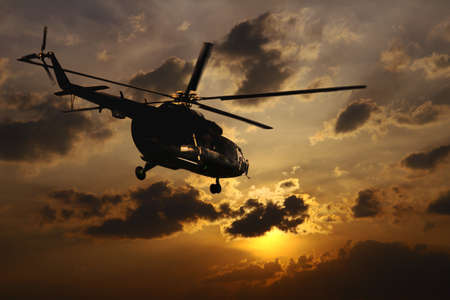 armed services: Helicopter landing at sunset