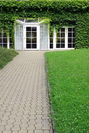 modern building with glass door and ivy Foto de archivo