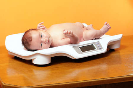 nude baby: baby boy on weight scale