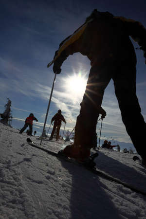 Czech mountains Krkonose in winter - silhouette active skier in lighting photo