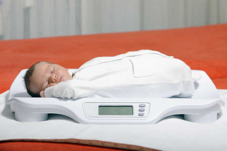 new medicine: baby boy on weight scale