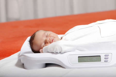 baby boy on weight scale photo