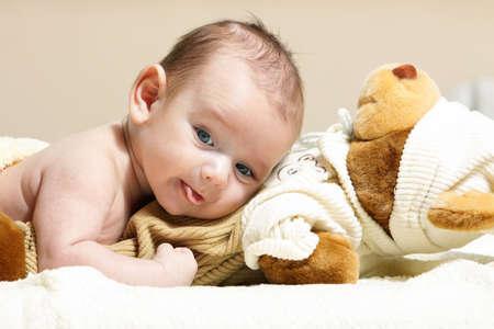 newborn lying on the cute toy bear