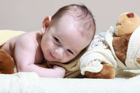 newborn lying on the cute toy bear