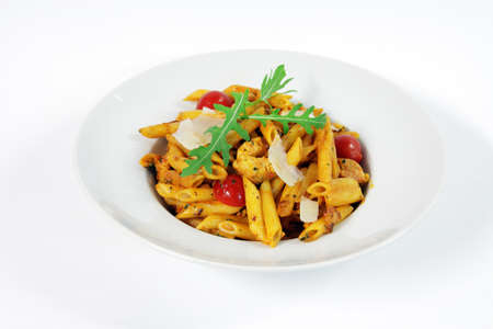 Penne alla vodka with chicken meat and salad rucola photo