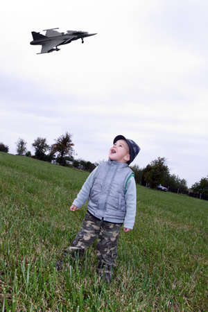 Child on meadows with fighter photo