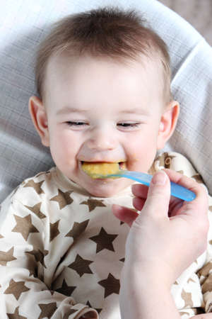 feed up: Baby boy eating vegetable mash
