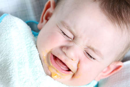 Crying baby boy eating vegetable mash Reklamní fotografie