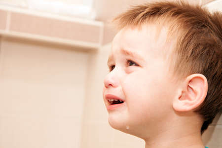 boy crying: Portrait Of Crying Baby Boy In Home.