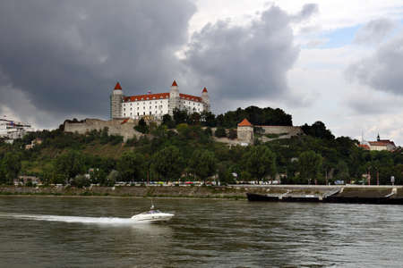 Bratislava (capital of Slovakia) castle with river Dunaj and motorboat