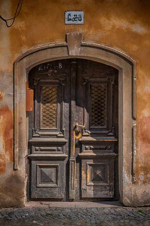 old wooden house Door in city Pardubice photo