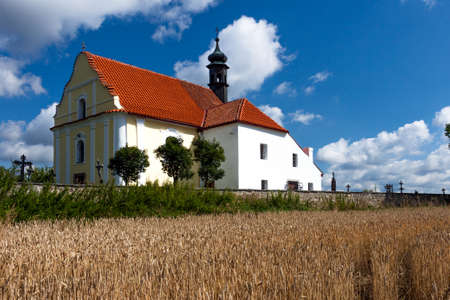 rabi: Small Church Near Cemetery and Village Rabi Stock Photo