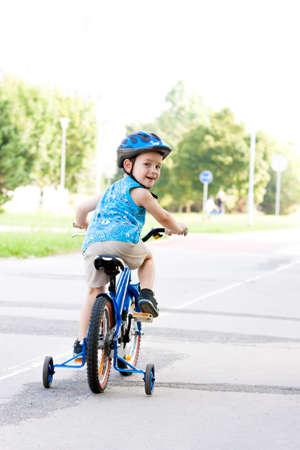 Baby boy on bike with crash helmet photo