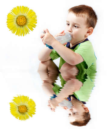 bronchial: Little boy using inhaler for asthma isolated on white  Stock Photo