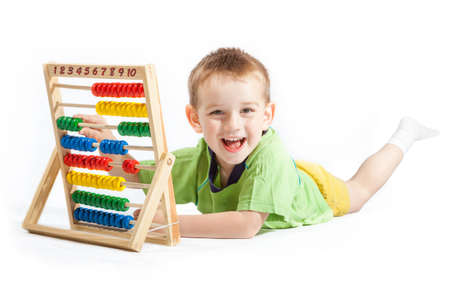 jolly baby boy with abacus isolated on white background photo