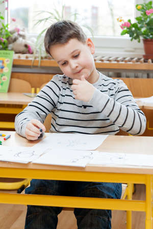 enrollment: Preschool boy doing enrollment to school