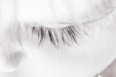 monochrome image close-up of eye of a sleeping child