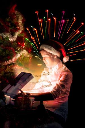 miracle tree: Christmas miracle, magic gift box and a man Stock Photo