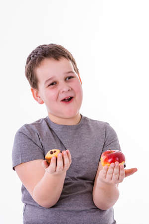 boy beautiful: little boy with food isolated on white background - apple or a muffin