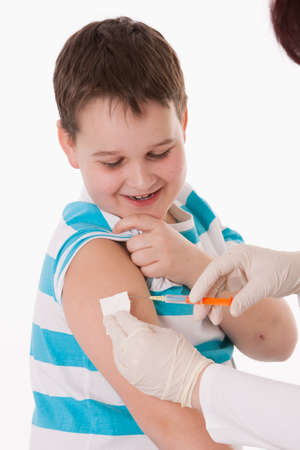 immunization: Doctor giving a child injection in arm on isolated image. Stock Photo