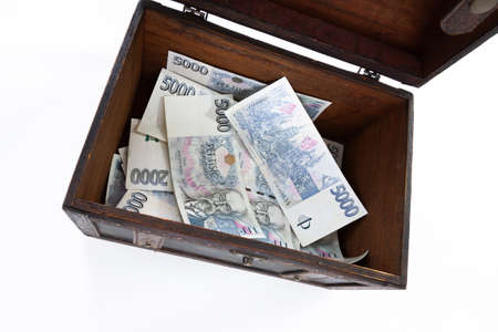 korun: Czech paper money and chest on white background