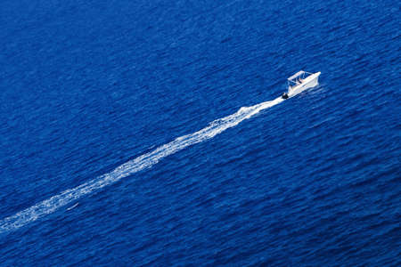 motor boat: Fast motor boat with splash and wave. Stock Photo